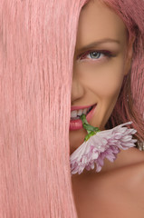 woman with pink hair and flower in his teeth