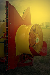 Agricultural equipment in sunset light. Detail 14