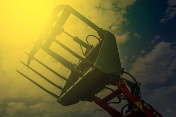 Agricultural equipment in sunset light. Detail 15