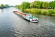 Leinwandbild Motiv Frachtschiff auf der Weser bei Nienburg