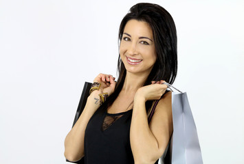 happy young brunette holding gift bags on a white background