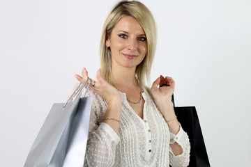happy young blonde woman holding gift bags
