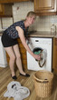 Woman using a washer dryer macine