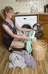 Woman using a washer dryer macine