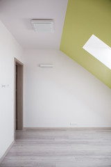 Attic room with sloped ceiling