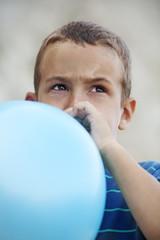 Child blowing ballon