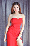 Beautiful lady in luxury red dress
