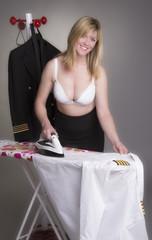 Pilot ironing her uniform shirt