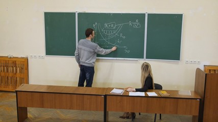 student answers at the blackboard