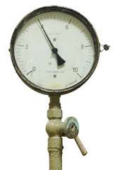 Old pressure gauge on an isolated background