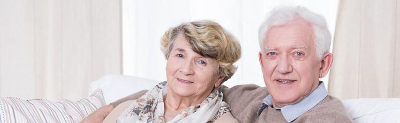 Man embracing his senior wife