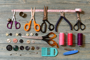 Scissors, thread, buttons and needles for sewing
