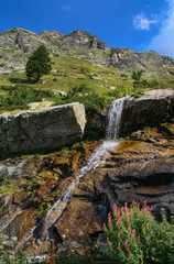 Little waterfall on the rocks, spring mountain
