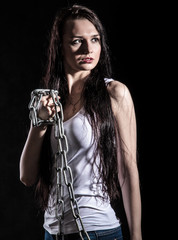 Portrait of a beautiful young woman with a steel chain