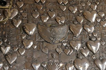 Metal hearts in the church Ostra Brama. Vilnius.