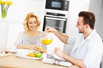 Young couple eating breakfast