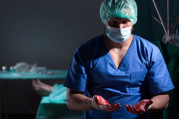 Surgeon with bloody hands