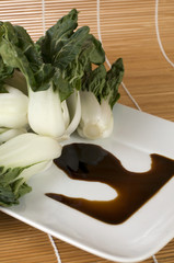 Bok Choy Vegetable on white Plate with Soya Sauce
