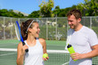 Tennis sport - couple relaxing after playing game - 81411155