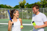 Tennis sport - couple relaxing after playing game