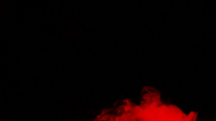 Red smoke on black isolated