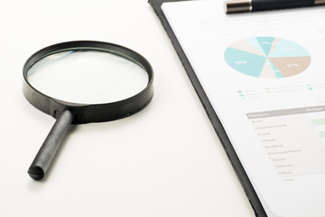 Document financial with magnifying glass.searching profit