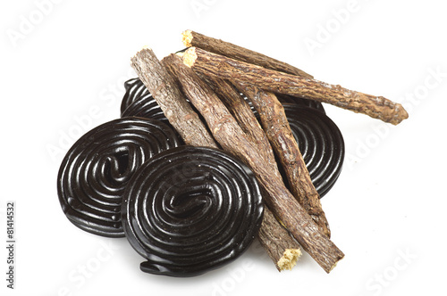 Fototapeta Licorice roots and licorice black on the white