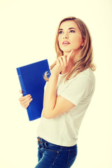 Young student woman thinking