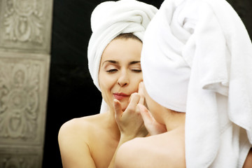 Woman squeeze her acne.