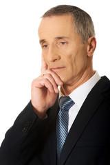 Portrait of a pensive businessman touching chin