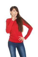 Young woman smoking cigarette.