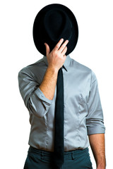 man in elegant suit that covers his face with a hat