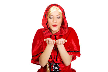 Woman as a Little Red Riding Hood blowing kiss.
