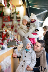 Happy family of four at Christmas market
