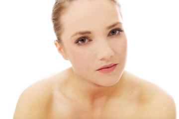 Beautiful young spa woman.