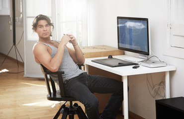 young man seat on his workplace. cosy apartment