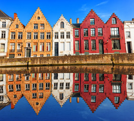 Bruges canals: Spinolarei reflected in the canal. Belgium