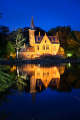 The Minnewater at twilight. Fairytale scenery in Bruges, Belgium