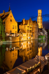 Dock of the Rosary and Belfry at twilight. Bruges, Belgium