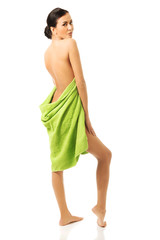 Full length back view woman wrapped in towel