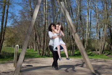 Mother and daughter have fun in the park