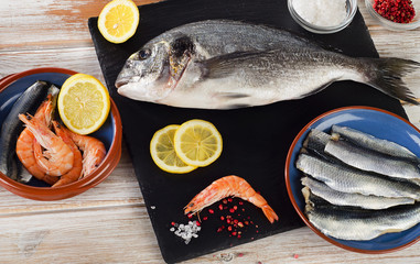 Fresh fish  with  spices , salt and shrimps - healthy food.