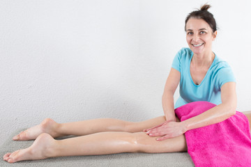 Young woman is ready for legs's massage at spa
