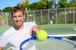 Tennis player portrait man showing ball and racket