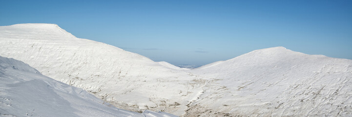 Stunning Winter panoramic landscape snow covered countryside wit