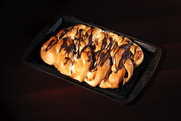 Chocolate and caramel danish pastry on a baking tray