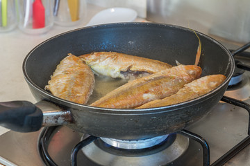 fish fillet cooking on fry pan, food preparation, cooking time