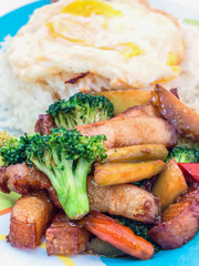 Pork stir-fried broccoli and chili with fried egg, Thai food