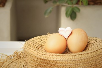 eggs on a background of brown hat.