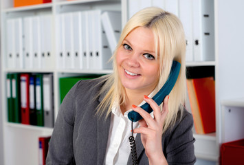 young blond businesswoman is calling